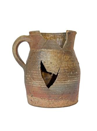 broken pot, a symbol of violence and failure