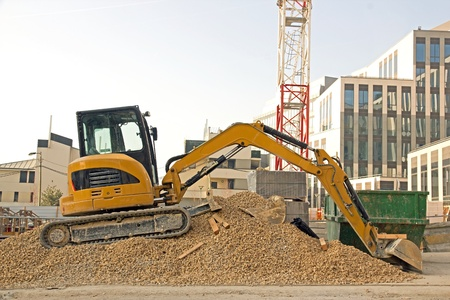 bulldozer waiting on piles of gravel Editorial