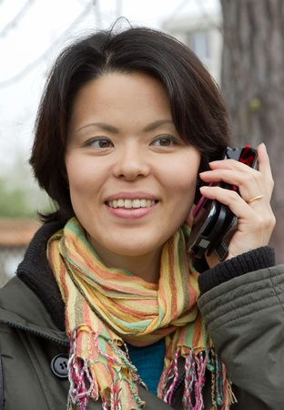 young woman with mobile phone Stock Photo - 13342903