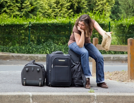self hiker sitting on his luggage, complete discouragement  Stock Photo - 14411279