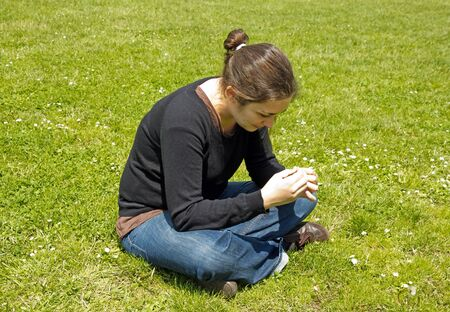woman dreaming in a field of daisies Stock Photo - 14477838