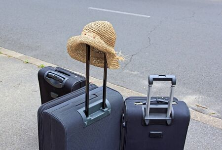 scheduled: ready for the scheduled trip, hat and bags  Stock Photo