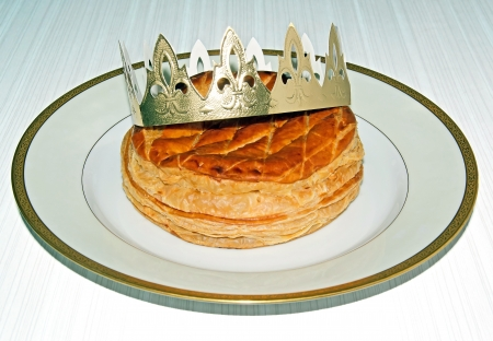 twelfth night: Twelfth-Night pancake and its crown, on kitchen table Stock Photo