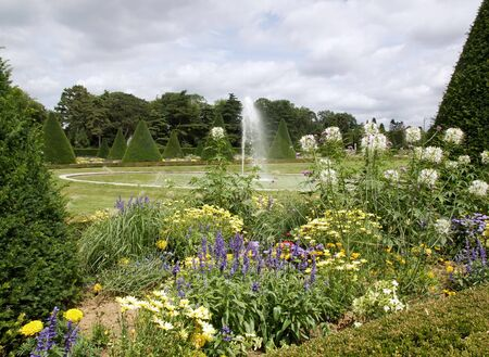 formal garden and fountain, water jet  France Stock Photo - 17037955
