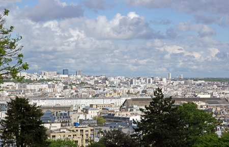 quoted: Roofs of Paris between sky and nature  France  Stock Photo