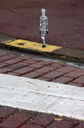 bod: Chap odd bod crossing a crosswalk, a man in the street