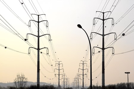 voltages: High-tension lines, the energy in perspective  France Europe   Stock Photo