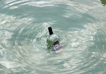 A bottle in the sea, empty bottle of alcohol in perdition