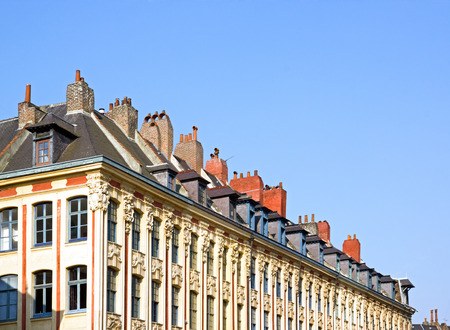 fireplaces: chimneys on a roof, Lille (Nord, France). Fireplaces Alignment, Lille France Stock Photo