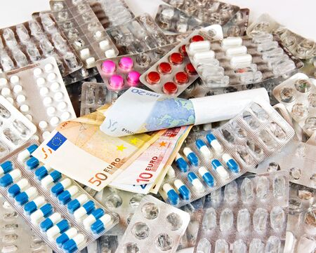 The cost of drugs. Drugs and money Euros.