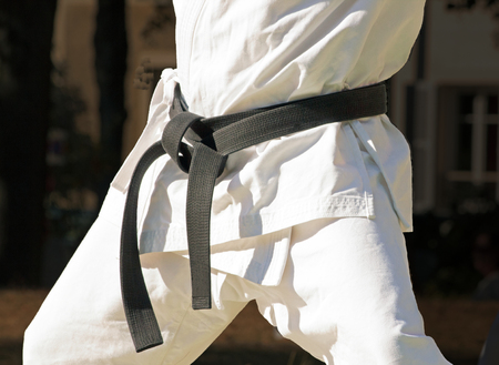 combat sport: black belt with a combat sport, close up on a fighter Stock Photo