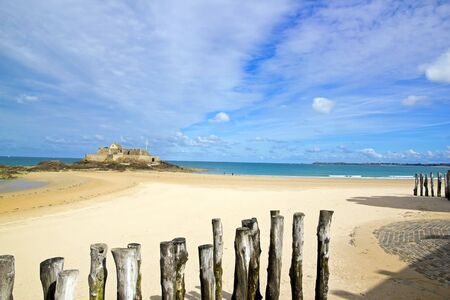 st malo: Saint-Malo, the beach in low tide and the national fort Brittany France Editorial