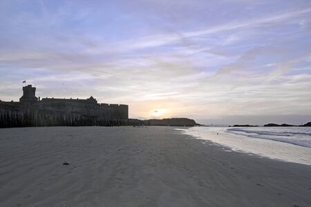 st  malo: Sunset in summer on the beach and the city of St Malo Brittany France Stock Photo