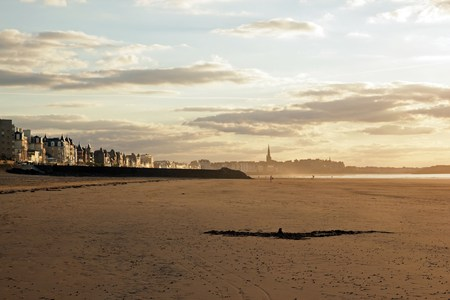 Saint Malo at dusk, the city and the beach Brittany France
