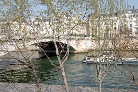 The banks of the Seine, trees and barges (Paris France) Stock Photo