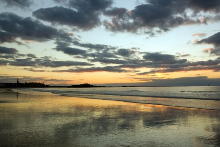 Sunset on the beach and the city of St Malo (Brittany, France)