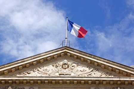 Emblems of France: French flag and helmeted head of the Republic on an official historic building (Paris France) Banco de Imagens