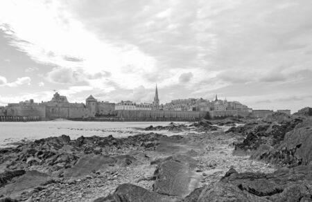 City of St Malo in low tide, under a cloudy sky. (Brittany, France).