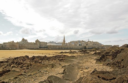 City of St Malo in low tide, under a cloudy sky. (Brittany France) Stock Photo