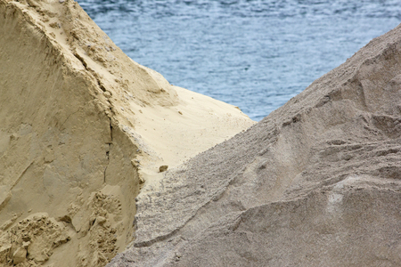 Sand stored on a dock of the Seine in Paris. Raw material in wait. France Stock Photo