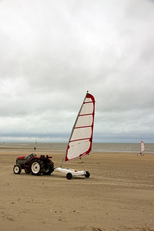 Tractor and sand yacht. Beach of Normandy (Trouville France) Stock Photo