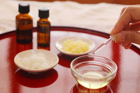 Red tray with aroma oil images Stock Photo - 86694548