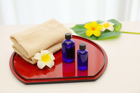 Two blue bottles on the red tray