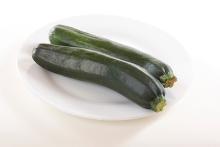 Zucchini on the plate isolated on white 写真素材