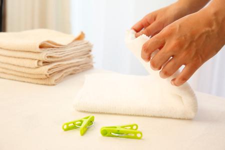 A hand of a woman folding a towel Zdjęcie Seryjne
