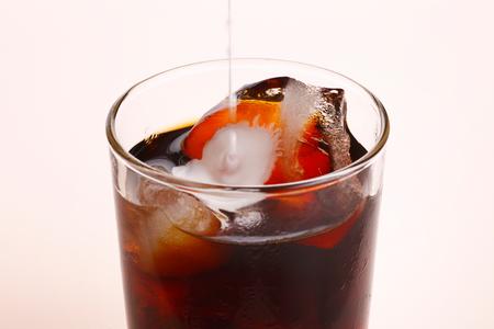 Pour milk into ice coffee