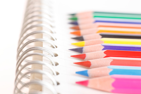 Colorful colored pencil and notebook