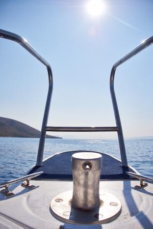 yacht approaching deserted Rocky Island in Croatia   photo