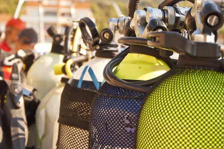 Diving equipment on a boat trip to the next diving spot  water in the background   Banco de Imagens