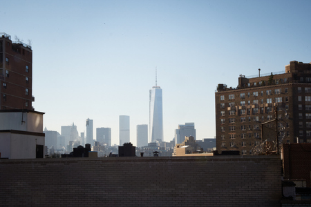 the Manhattan skyline water-towers and rooftops, concrete jungle in New York, looking the roof and skyline in the background