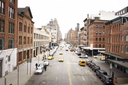 colorful city scene with traffic at bright daylight in New York Citys trendy Meatpacking District from the High Line Park photo