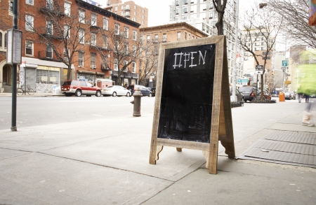 wooden chalk board outside of shop open for business, Manhattan, New York.