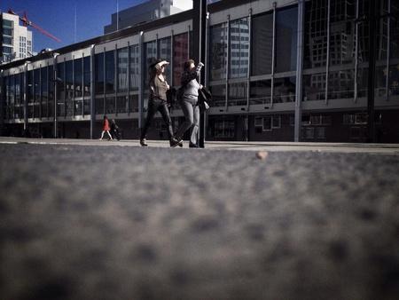 Two friends walking in city Stok Fotoğraf