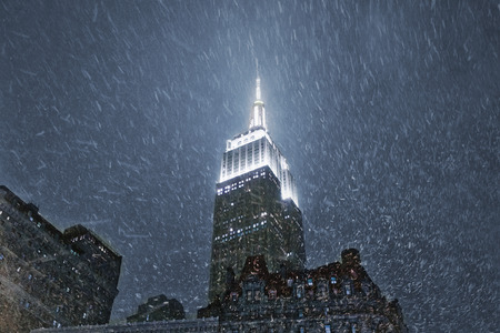 New York, USA – December 08, 2013: Chrysler Building in New York. The Chrysler Building is an Art Deco style skyscraper in New York City, located on the east side of Manhattan. Nightshot with snow