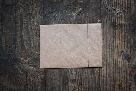 old envelope: brown envelope on wooden background