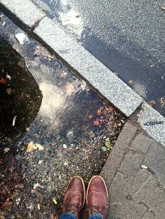 predicted: standing next to the street in Frankfurt, Germany. Big puddles after heavy rain. Thunderstorm predicted on the 31.03.2015