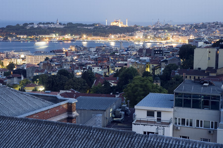 river scape: A good view over the rooftops of the high rising building in istanbul with the Bosphorus seen behind a hill and the mosque of Sultan Ahmet in the distance Editorial