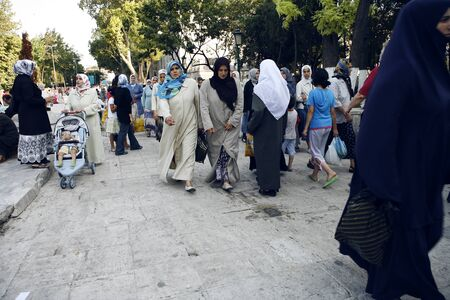 garb: A huge group of muslim women with kerchiefs and long garbs passing by in Istanbul, Turkey