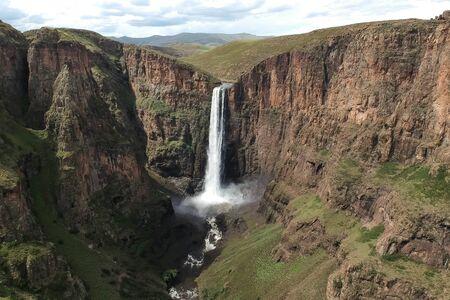 stunning waterfall running down a steap canyon Stockfoto