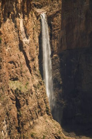 view of majestic waterfall flowing off the clips