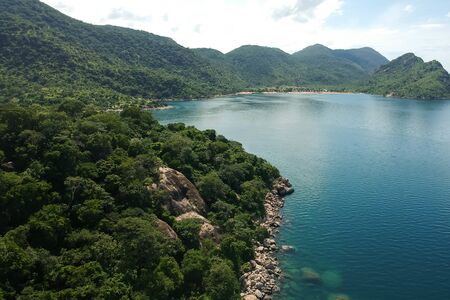 aerial shot with drone of green mountains and blue water Stockfoto