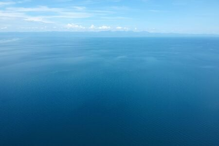 drone shot of the blue seascape with little clouds
