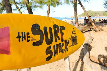 yellow surfboard sign leading to the surf shack in Tofo, Mozambique