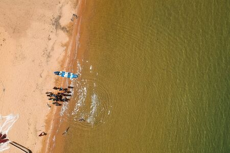 drone shot of fishermen coming back from work