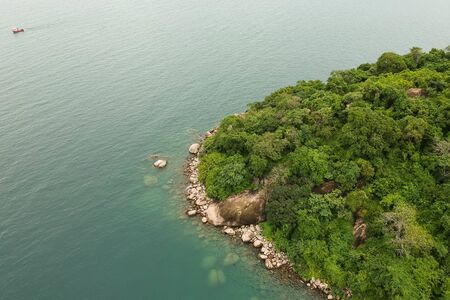 top view drone shot of a stoney cliff of a coastline