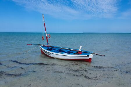 wooden sailing boat for safari tours in turquoise water